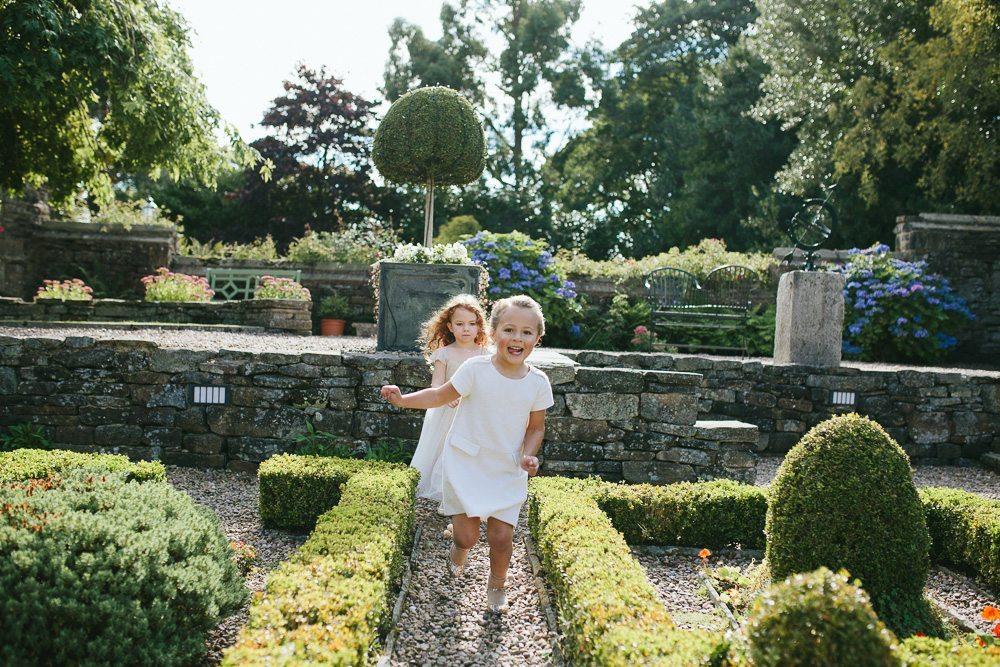 Tim Dunk Wedding Photography bridesmaids running gardens Holdsworth House wedding venue
