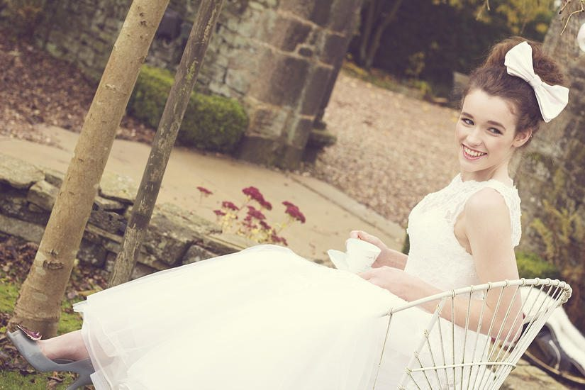 Rebecca Jagger Milliner bride at Holdsworth House with teacup