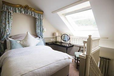 split-level upper suite bedroom